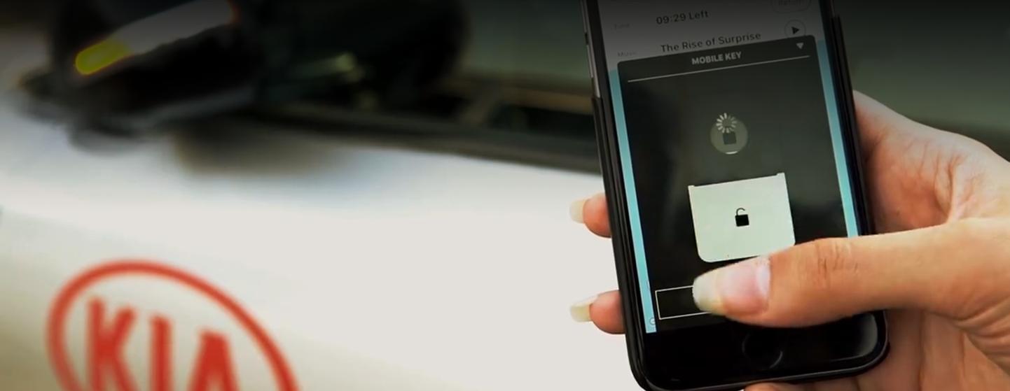 kia-mobile-app-woman-unlocking-car