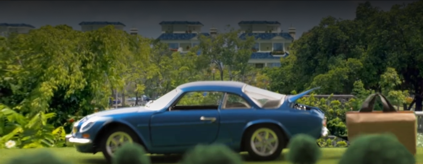 mountain-view-stop-motion-screenshot-with-blue-car-trees