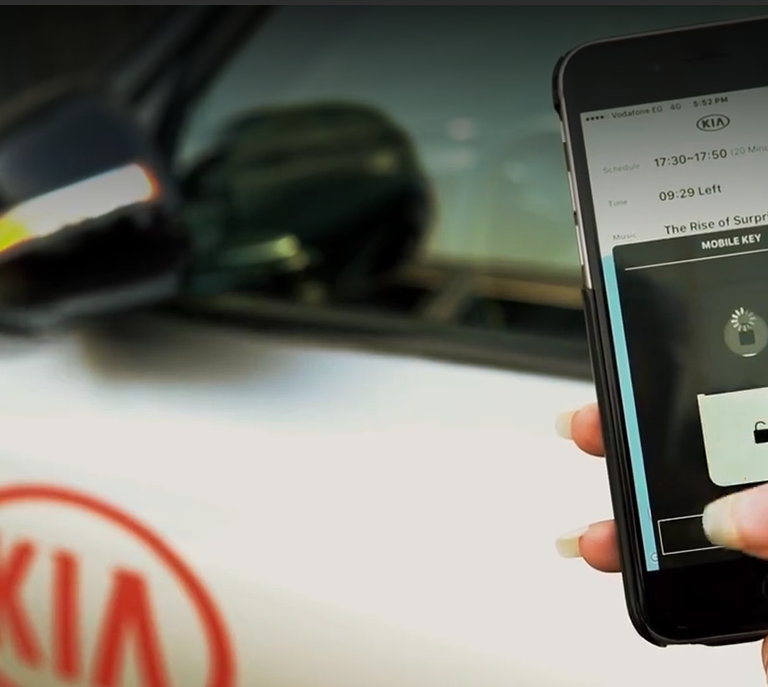 kia-mobile-app-woman-unlocking-car